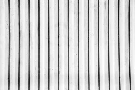 crannied: Wall of vertical strips of white concrete Stock Photo