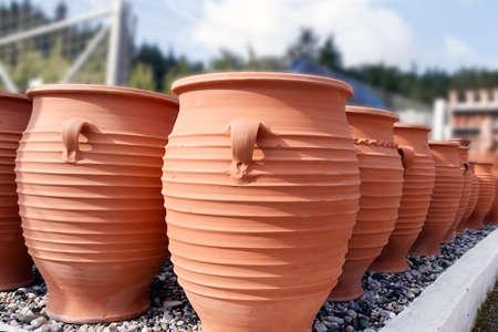 Group of red handmade ceramic jugs. pots Stock Photo