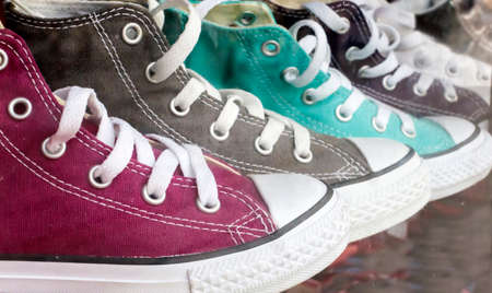 Different colored sneakers in line