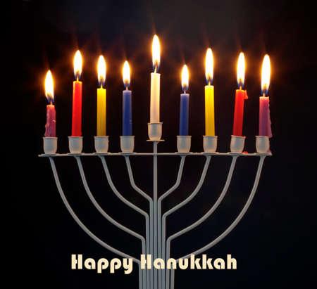 Happy Hanukkah jewish holiday. Menorah traditional candelabra with burning candles against black background Фото со стока