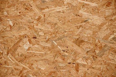 Background of yellow pressed wood chips Standard-Bild