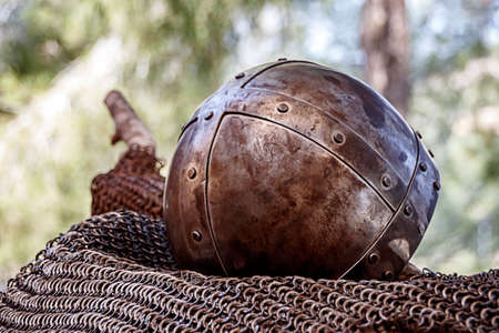 An ancient knightly helmet covered with rust