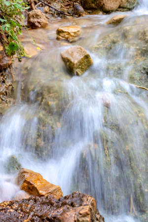Small cascades of waterfalls on a mountain stream in the spring. Parod River. Israel. Landscape 写真素材
