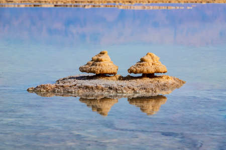 Close-up reflection of salt formations in the water of the Dead Sea