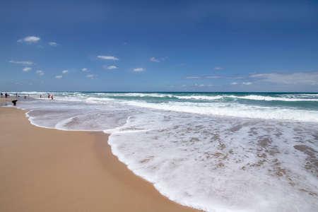 Mediterranean sandy beach. Sea waves incident on the shore. Seascape 写真素材