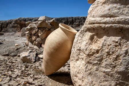 Amphora leaning against the ruin of a building in the ancient city of Zipory, National Park, Israel.