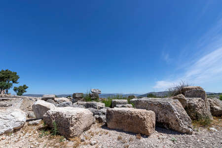 Large stone ruins of the ancient city of Zippori against the backdrop of the Galilee Mountains and the blue sky. Israel. Tourism and travel