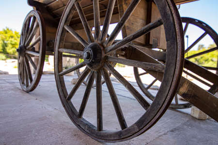 Side view of the wooden wheels of an ancient cart. The historic city of Zipory, Israel. Tourism and travel 写真素材