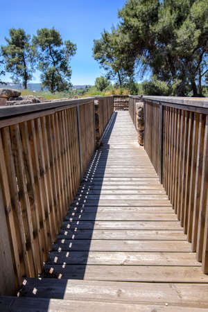 Tourist wooden bridge in the ancient city of National Park Zippori. Israel. 写真素材