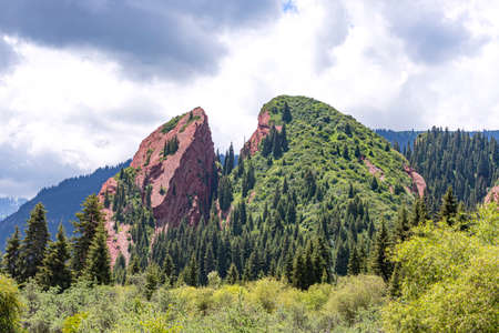 Rock Broken Heart in the Jeti Oguz gorge Kyrgyzstan is covered with coniferous forest.