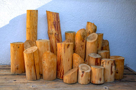 Processed round wooden tree trunks of different sizes close-up