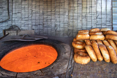 Hot Tandoor for baking and ready-made oriental flatbreads close up on the market