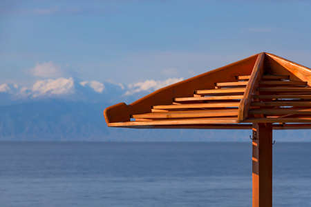 Part of a parasol close-up on the background of Lake Issyk-Kul. Kyrgyzstan Stock Photo