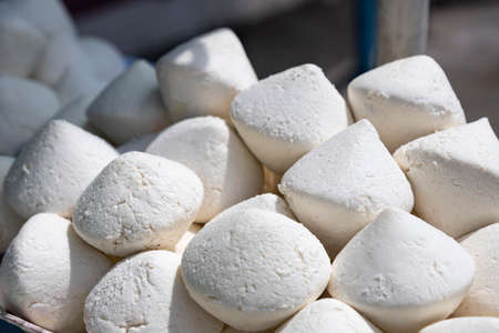 White lumps of national food kurt in the Kyrgyz market