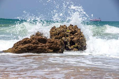 Sea waves crashing on stone formations on the shore of Ashkelon National Park. Israel