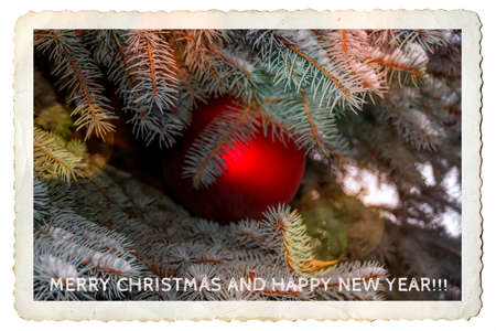 Unique art digital merry christmas and happy new year postcard designed from beautiful photo of a cristmas tree in snow and a red ball. Stock Photo