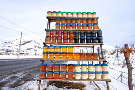 Diggerent jars of honey on the roadside market. Georgian military road 版權商用圖片