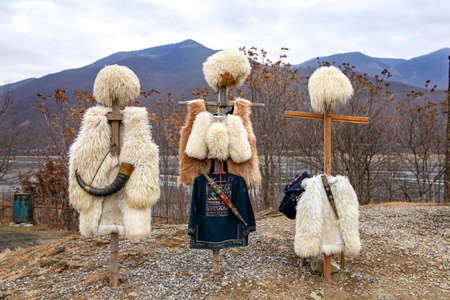 National clothes of Georgian shepherds burka and hat against mountains. Georgia