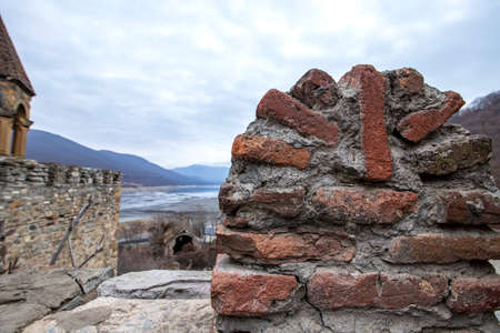 Tower and protective wall of the fortified Ananuri castle on the background of the Zhinvali reservoir. Georgian military road 版權商用圖片