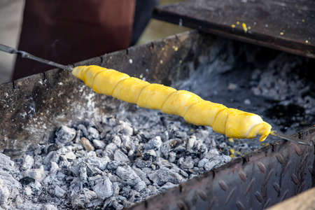 Khachapuri on the skewer preparing on a grill. Georgia
