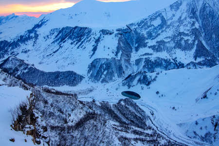 Sunset in the snowy mountains of Gudauri with a small round lake in the valley. Georgia 版權商用圖片