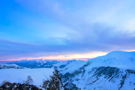 Sunset in the snow-covered mountains of Gudauri. Georgia