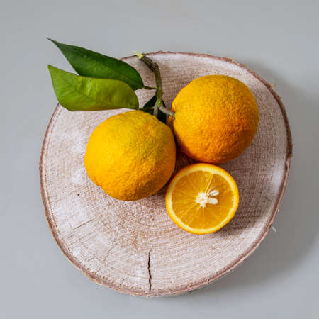 Still life. Flatlay on oranges fruits on wooden board close up