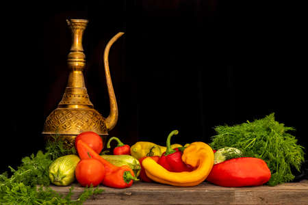 Still life of fresh natural vegetables on a black background. Peppers, zucchini, tomatoes, dill. 版權商用圖片