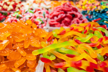 Colorful oriental sweets of various shapes close-up on a market counter Stok Fotoğraf