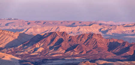 View of the mountain ranges of Ramon Crater at sunset. The Negev Desert. Israel