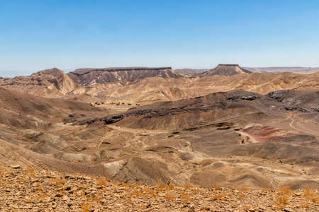 View of the Ramon crater colorful mountains with traces of geological events. Negev desert. Israel Фото со стока