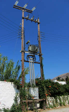 powerline: Powerline and transformer in Mykonos, Greece Stock Photo