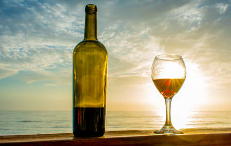Beautiful glass of wine with beautiful and amazing sunset 版權商用圖片