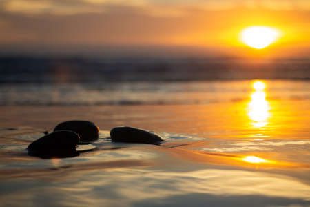 stones with different shapes with a sunset with bright colors