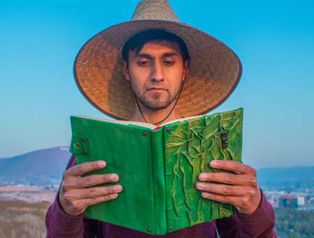 adventurer reading green book with hat and beautiful bright colors