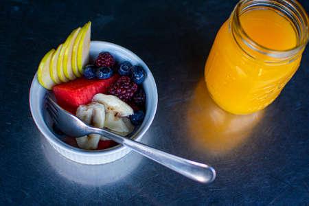 berries fruit, apple with delicious orange juice, brunch food.