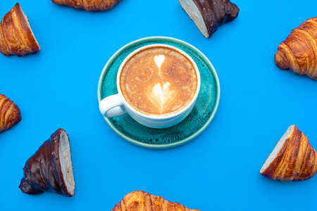 delicious croissants with a cup of coffee with pattern style and blue background Archivio Fotografico - 131622815