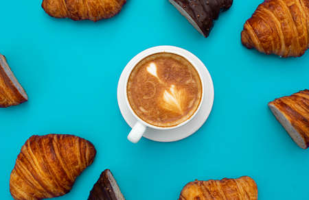 delicious croissants with a cup of coffee with pattern style and blue background Archivio Fotografico - 131622814