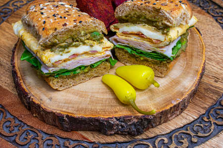 delicious sandwich with panini bread, chips and yellow chili