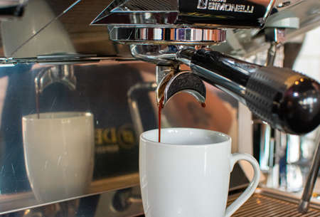 delicious coffee preparation with portafilter and tamper, professional concept