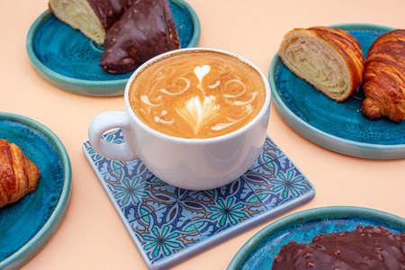 Delicious coffee with croissants, pattern concept, quite bright colors. Archivio Fotografico - 131622855