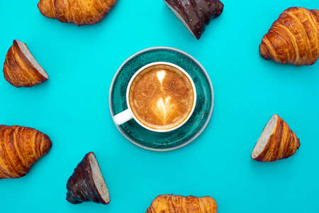 delicious croissants with a cup of coffee with pattern style and blue background