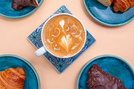 Delicious coffee with croissants, pattern concept, quite bright colors.
