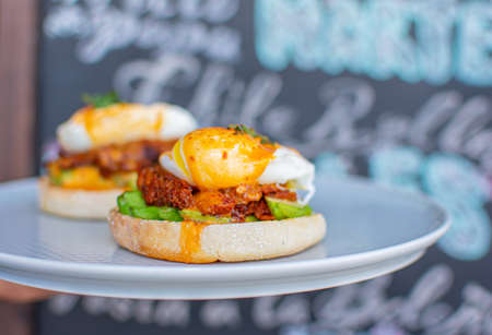 Delicious Benedictine eggs with chilorio typical of Mexican cuisine and brunch