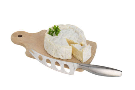 Camembert cheese cut on a wooden board