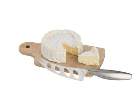 Camembert on cutting bord with knife Stock Photo