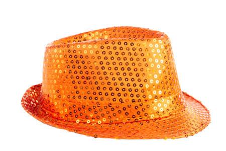 Orange sequined hat on white background