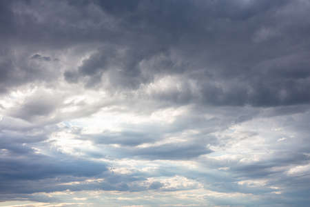 Dark clouds in a gray sky, dramatic background