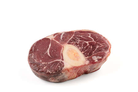 raw beef shank for pot au feu on white background