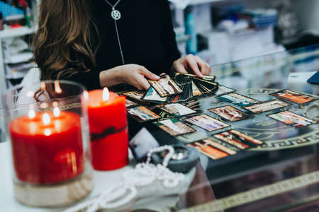 Tarot cards, girl divination on tarot cards